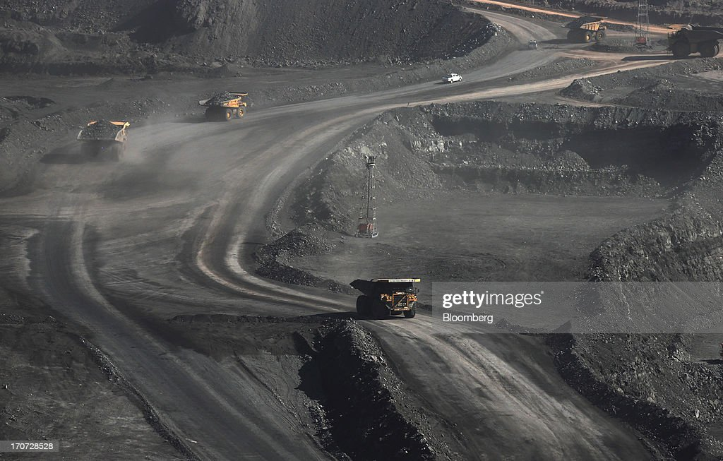Trucks carry coal at the open pit in Ukhaa Khudag section of the Tavan Tolgoi coal deposit, developed by Energy Resources LLC, in South Gobi, Mongolia, on Thursday, June 6, 2013. Mongolia, a country of almost 2.9 million people, has some of the world's biggest undeveloped mineral reserves, including Oyu Tolgoi, a copper and gold mine, and Tavan Tolgoi, a coal deposit. Photographer: Tomohiro Ohsumi/Bloomberg via Getty Images
