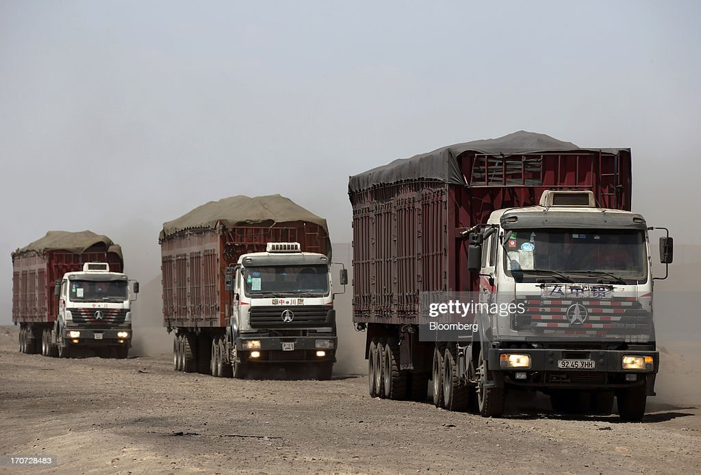 Trucks carry coal to a reloading facility on the border with China in South Gobi, Mongolia, on Thursday, June 6, 2013. Mongolia, a country of almost 2.9 million people, has some of the world's biggest undeveloped mineral reserves, including Oyu Tolgoi, a copper and gold mine, and Tavan Tolgoi, a coal deposit. Photographer: Tomohiro Ohsumi/Bloomberg via Getty Images