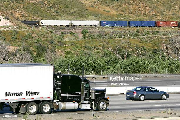 Trucks cars and freight trains travel through Cajon Canyon near the San Andreas Fault on July 1 2006 near San Bernardino California The Interstate 15...