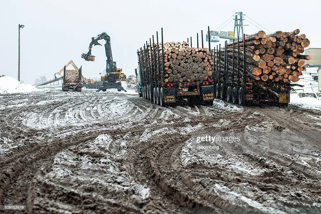 Trucks deliver raw lumber yard at the Resolute Forest Products mill in Thunder Bay Canada Ontario on Friday Jan 8 2016 Resolute Forest Products the...