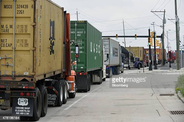 Trucks delivering containers wait to enter the Port of Newark in Newark New Jersey US on Thursday June 18 2015 The US Senate paved the way for a...