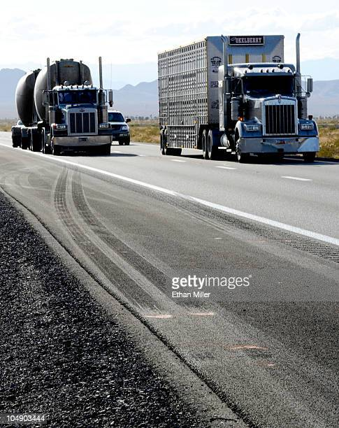 Trucks drive by skid marks from a semitractor trailer on northbound Interstate 15 on October 6 2010 near Mesquite Nevada Steve Lee frontman for the...
