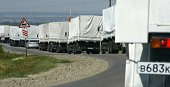 Trucks from a Russian humanitarian convoy arrive outside the town of KamenskShakhtinsky in the Rostov region some 30kms from the RussianUkrainian...
