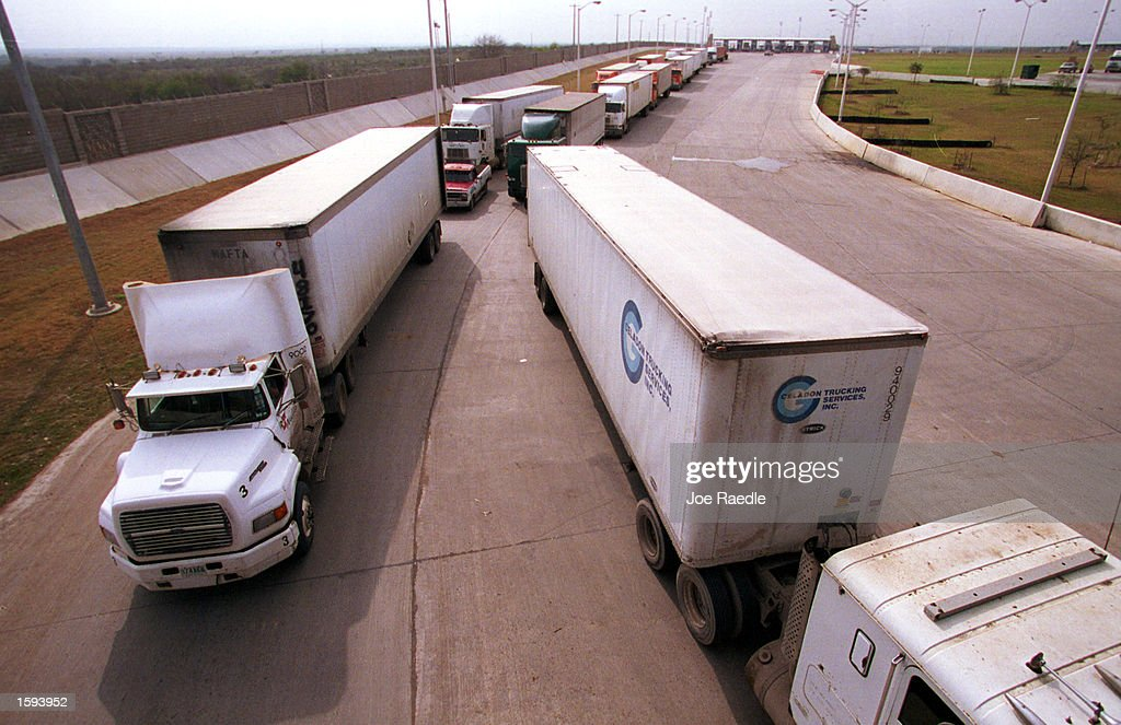 Trucks from Mexico queue as they wait to enter the United States at a border crossing point February 14, 2001 from Neuvo Laredo, Mexico to Laredo, TX. The D.O.T. inspectors check trucks for safety violations as they enter the United States from Mexico. The Bush administration has indicated that it would reverse a Clinton administration policy and uphold the North American Free Trade Agreement by allowing Mexican trucks to haul goods throughout the United States.