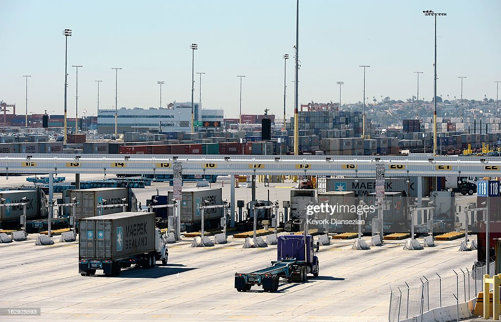Trucks hauling containers arrive at the Port of Los Angeles on March 1, 2013 in Los Angeles, California. Reports say that teh across the board sequestration budget cuts could slow movement of goods through U.S. ports.