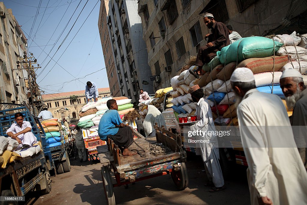 Trucks laden with goods stand in Jodia Bazar in Karachi, Pakistan, on Wednesday, Oct. 31, 2012. Businesses in Pakistan's commercial capital are bracing for a surge in extortion demands as parties representing the city's ethnic communities seek to use their hired guns to build financial war chests ahead of parliamentary polls due in the first half of next year. Photographer: Asim Hafeez/Bloomberg via Getty Images