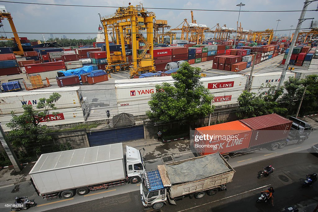 Trucks line the road as containers sit stacked at the Port of Bangkok, Thailand, on Monday, Aug. 25, 2014. Thailand's trade figures are scheduled for release on Aug. 27. Photographer: Dario Pignatelli/Bloomberg via Getty Images