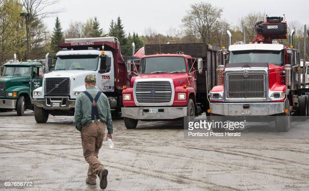 Trucks line up for a brigade through Canaan before the funeral for Butch Clark a milk hauler who died in January when his Mack truck left the roadway...