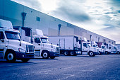 Trucks loading unloading at warehouse logistics transportation concept image