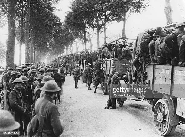Trucks of motor transport service leaving with troops of 7th Infantry being relieved for rest bear Moulins On road West of Moulins 30th July 1918
