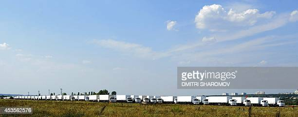 Trucks of Russian humanitarian convoy wait at the location outside Voronezh some 400 km outside Moscow on August 13 2014 A massive Russian aid convoy...