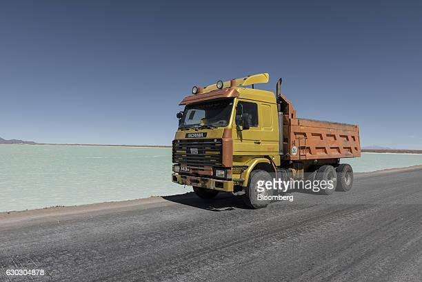 A trucks passes a new industrial evaporation pool inside the Salar de Uyuni in Potosi Bolivia on Saturday Dec 10 2016 Bolivia has the largest lithium...