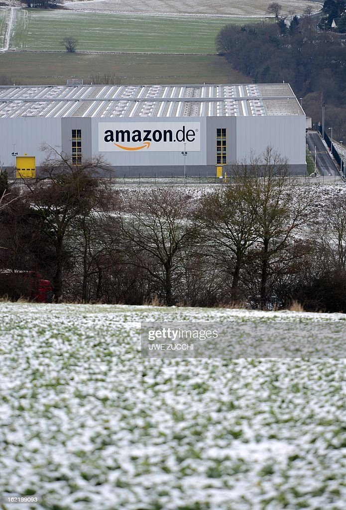 A trucks passes the German logistics center of online retailer Amazon in Bad Hersfeld, western Germany on February 20, 2013. The German competition watchdog on Wednesday, February 20, 2013 launched an investigation into the policy of online retailer Amazon which bans third-party traders from selling their products cheaper elswhere on the web. AFP PHOTO / UWE ZUCCHI GERMANY OUT