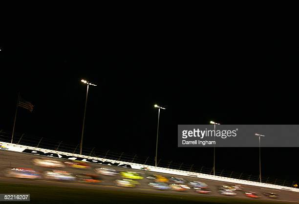 Trucks race under the lights during the NASCAR Craftsman Truck Series Florida Dodge Dealers 250 at the NASCAR Nextel Cup Daytona 500 on February 18...