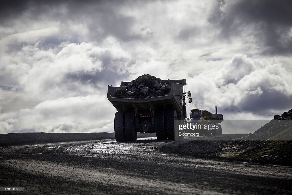 Trucks remove waste stone and iron ore from the open cast iron ore mine run by LKAB, Sweden's state-owned mining company, in Svappavaara near Kiruna, Sweden, on Thursday, Aug. 22, 2013. Swedes living in the Arctic town of Kiruna are packing up their belongings before their homes are bulldozed to make way for iron ore mining driven by Chinese demand. Photographer: Casper Hedberg/Bloomberg via Getty Images