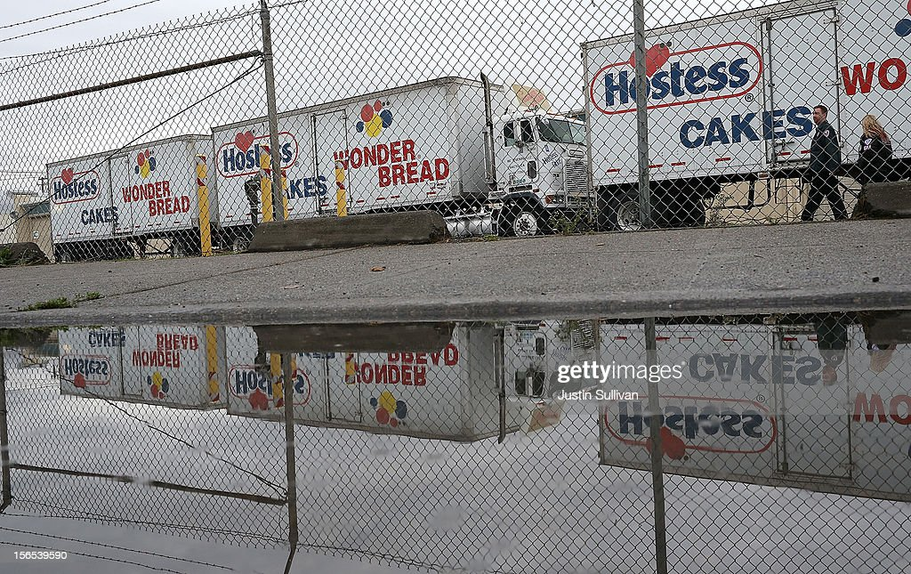 Trucks sit idle at the Hostess baking facility on November 16, 2012 in Oakland, California. Hostess Brands, the maker of Twinkies, Ding Dongs and Wonder Bread, announced plans to liquidate its assets and lay off nearly 18,500 employees due to a workers strike brought on by an imposed contract that would cut workers' wages by 8 percent.