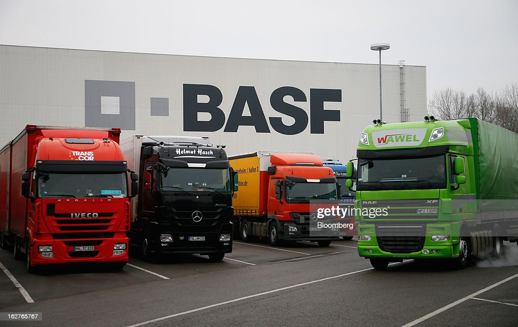 Trucks sit in parking bays outside a distribution warehouse at BASF SE's headquarters in Ludwigshafen, Germany, on Tuesday, Feb. 26, 2013. BASF SE forecast growth in earnings and sales this year after demand for plastics used to lighten cars and higher oil production buoyed quarterly earnings. Photographer: Ralph Orlowski/Bloomberg via Getty Images