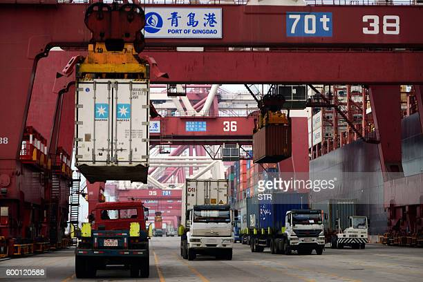 Trucks transport containers at a port in Qingdao east China's Shandong province on September 8 2016 China's imports rose 15 percent yearonyear in...