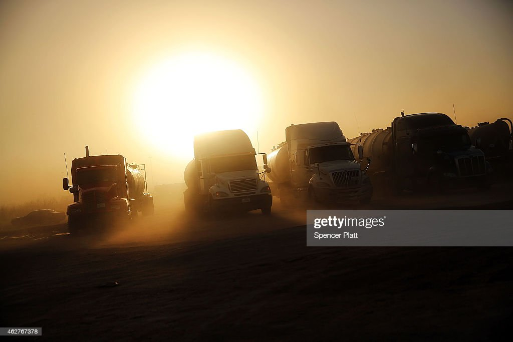 Trucks used in the fracking industry sit in a truck stop many waiting for work on February 4 2015 in Odessa Texas As crude oil prices have fallen...