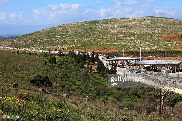Trucks wait at the Cilvegozu border crossing between Turkey and Syria near Hatay on February 13 2013 in the vicinity of the site where a vehicle...
