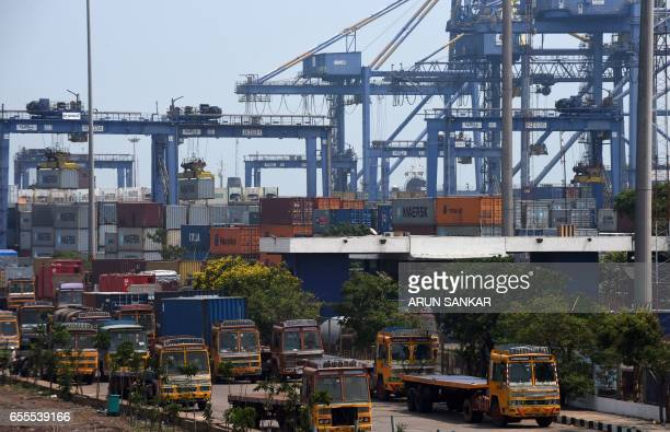 Trucks waits to exit a container terminal in Chennai on March 20 2017 Indian Directorate of Revenue Intelligence and customs officials are searching...