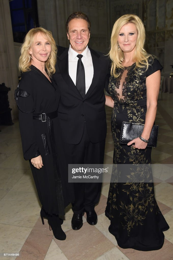 Trudie Styler, Andrew Cuomo, and Sandra Lee attend the Elton John AIDS Foundation Commemorates Its 25th Year And Honors Founder Sir Elton John During New York Fall Gala at Cathedral of St. John the Divine on November 7, 2017 in New York City.