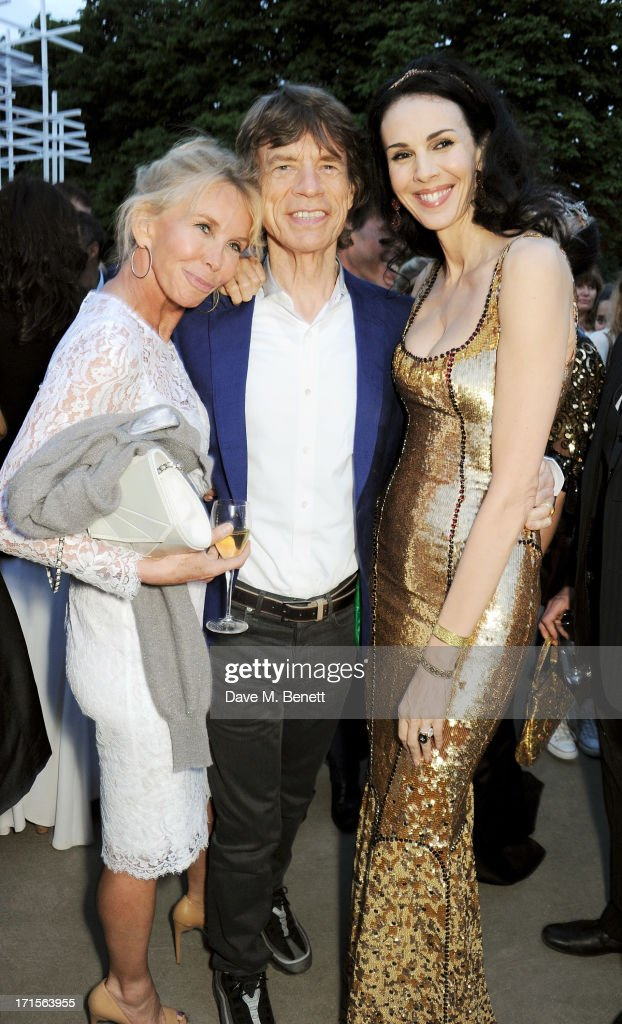 <a gi-track='captionPersonalityLinkClicked' href=/galleries/search?phrase=Trudie+Styler&family=editorial&specificpeople=203268 ng-click='$event.stopPropagation()'>Trudie Styler</a>, <a gi-track='captionPersonalityLinkClicked' href=/galleries/search?phrase=Mick+Jagger&family=editorial&specificpeople=201786 ng-click='$event.stopPropagation()'>Mick Jagger</a> and <a gi-track='captionPersonalityLinkClicked' href=/galleries/search?phrase=L%27Wren+Scott+-+Fashion+Designer&family=editorial&specificpeople=566708 ng-click='$event.stopPropagation()'>L'Wren Scott</a> attend the annual Serpentine Gallery Summer Party co-hosted by <a gi-track='captionPersonalityLinkClicked' href=/galleries/search?phrase=L%27Wren+Scott+-+Fashion+Designer&family=editorial&specificpeople=566708 ng-click='$event.stopPropagation()'>L'Wren Scott</a> at The Serpentine Gallery on June 26, 2013 in London, England.