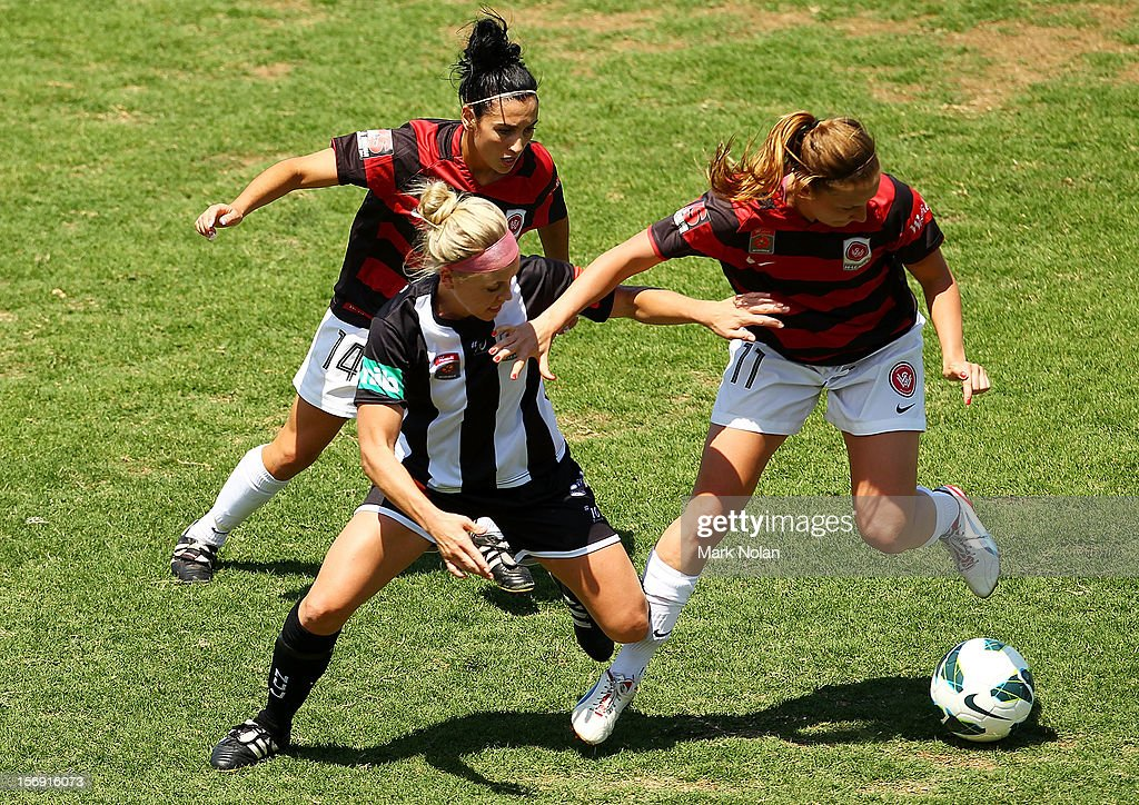 Trudy Camilleri and Louise Fors of the Wanderers contest possession with Tiffany Boshers of the Jets during the round six W-League match between the Western Sydney Wanderers and the Newcastle Jets at Campbelltown Sports Stadium on November 25, 2012 in Sydney, Australia.