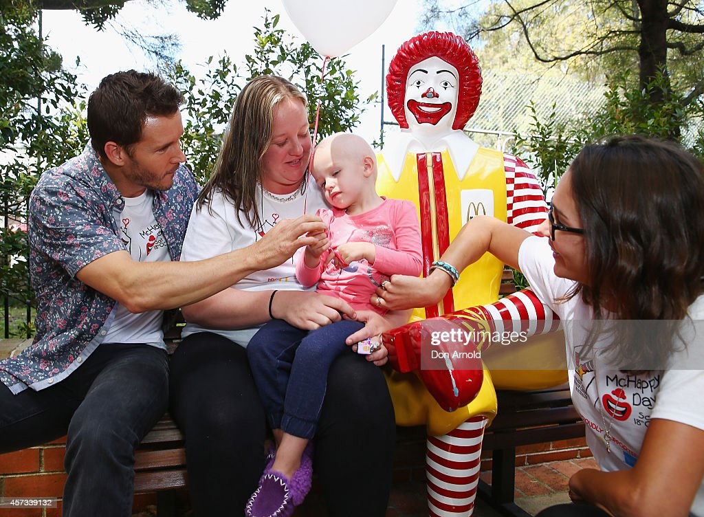 True Blood star Ryan Kwanten and his girlfriend Ashley Sisino chat with Coby Davies and her mother Shae Hately at Ronald McDonald House Randwick on...