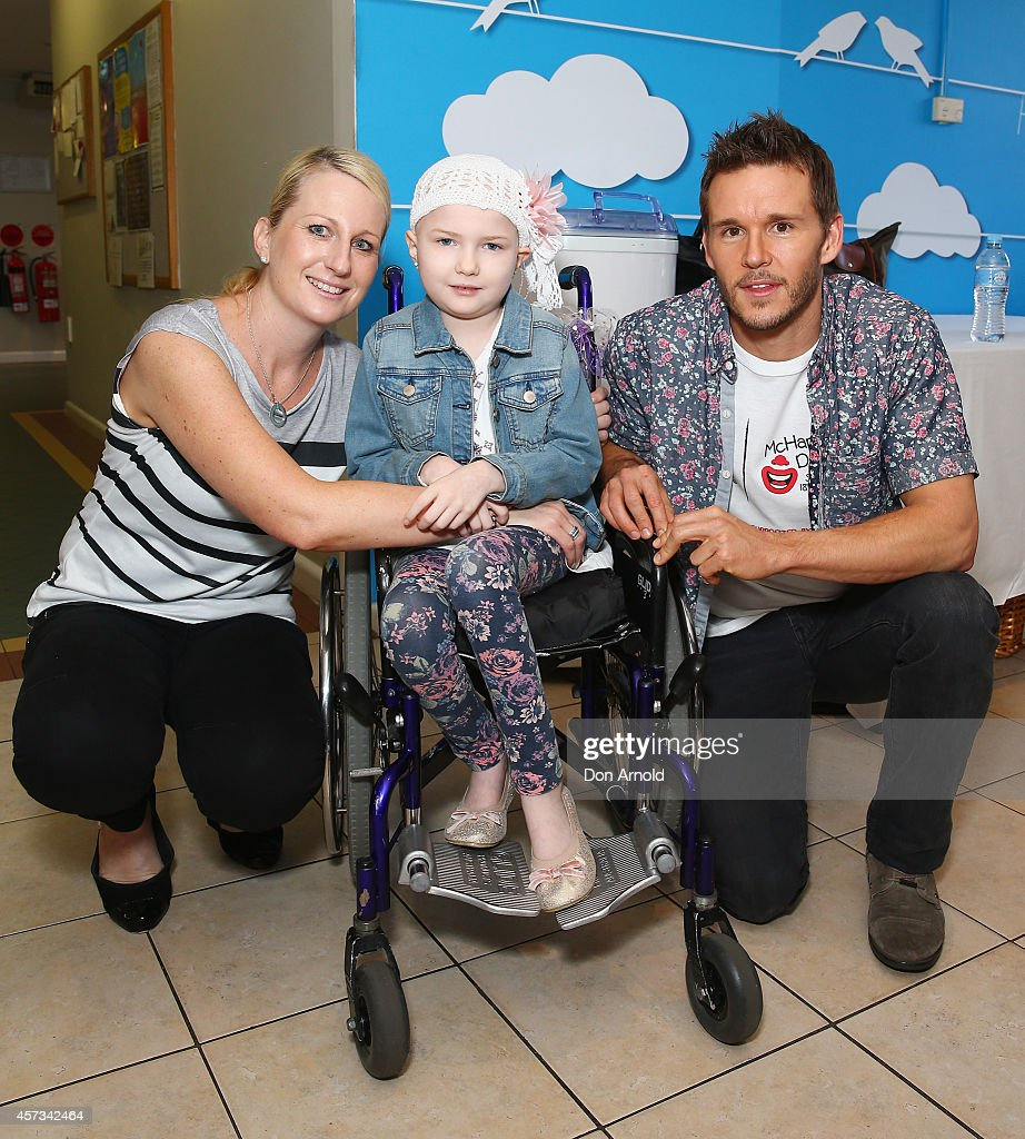 True Blood star Ryan Kwanten chats with Lexi Witton and her mother Shannon Witton at Ronald McDonald House Randwick on October 17 2014 in Sydney...