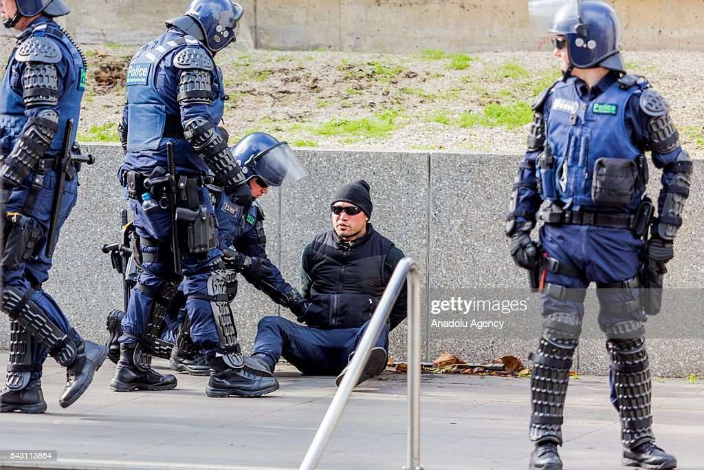 A True Blue Crew is arrested by police during a protest organized by the anti-Islam True Blue Crew supported by the United Patriots Front in Melbourne, Australia on June 26, 2016.