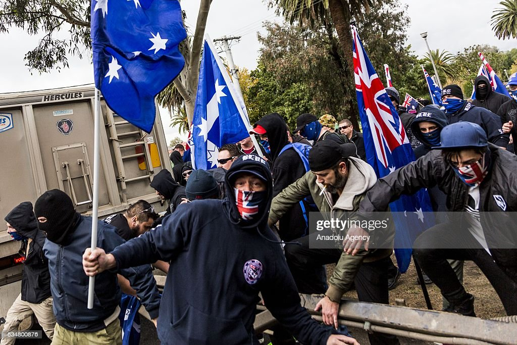 True Blue Crew jump over a truck carriage to attack Anti Fascists during a 'Say No To Racism' protest and a counter 'Stop the Far Left' rally in Coburg Melbourne, Australia on May 28, 2016. Seven men were arrested after a violent brawl erupted between rival protesters at an anti-racism rally in Melbourne's inner-north. Anti-Facists clashed with Anti-Islam nationalists who go by the name 'True Blue Crew'.