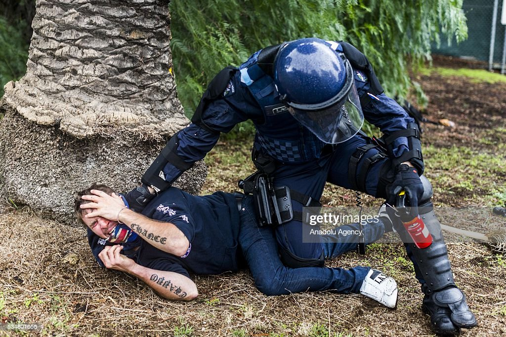 A True Blue Crew member is apprehended by a police officer during a 'Say No To Racism' protest and a counter 'Stop the Far Left' rally in Coburg Melbourne, Australia on May 28, 2016. Seven men were arrested after a violent brawl erupted between rival protesters at an anti-racism rally in Melbourne's inner-north. Anti-Facists clashed with Anti-Islam nationalists who go by the name 'True Blue Crew'.