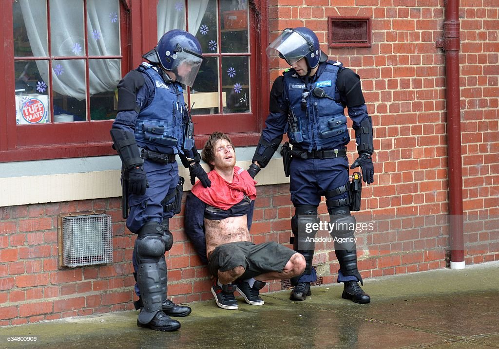 A True Blue Crew member is apprehended by police officers during a 'Say No To Racism' protest and a counter 'Stop the Far Left' rally in Coburg Melbourne, Australia on May 28, 2016. Seven men were arrested after a violent brawl erupted between rival protesters at an anti-racism rally in Melbourne's inner-north. Anti-Facists clashed with Anti-Islam nationalists who go by the name 'True Blue Crew'.