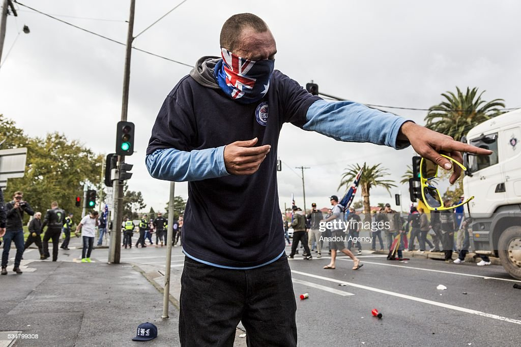 A True Blue Crew member is seen after being pepper sprayed during a 'Say No To Racism' protest and a counter 'Stop the Far Left' rally in Coburg Melbourne, Australia on May 28, 2016. Seven men were arrested after a violent brawl erupted between rival protesters at an anti-racism rally in Melbourne's inner-north. Anti-Facists clashed with Anti-Islam nationalists who go by the name 'True Blue Crew'.