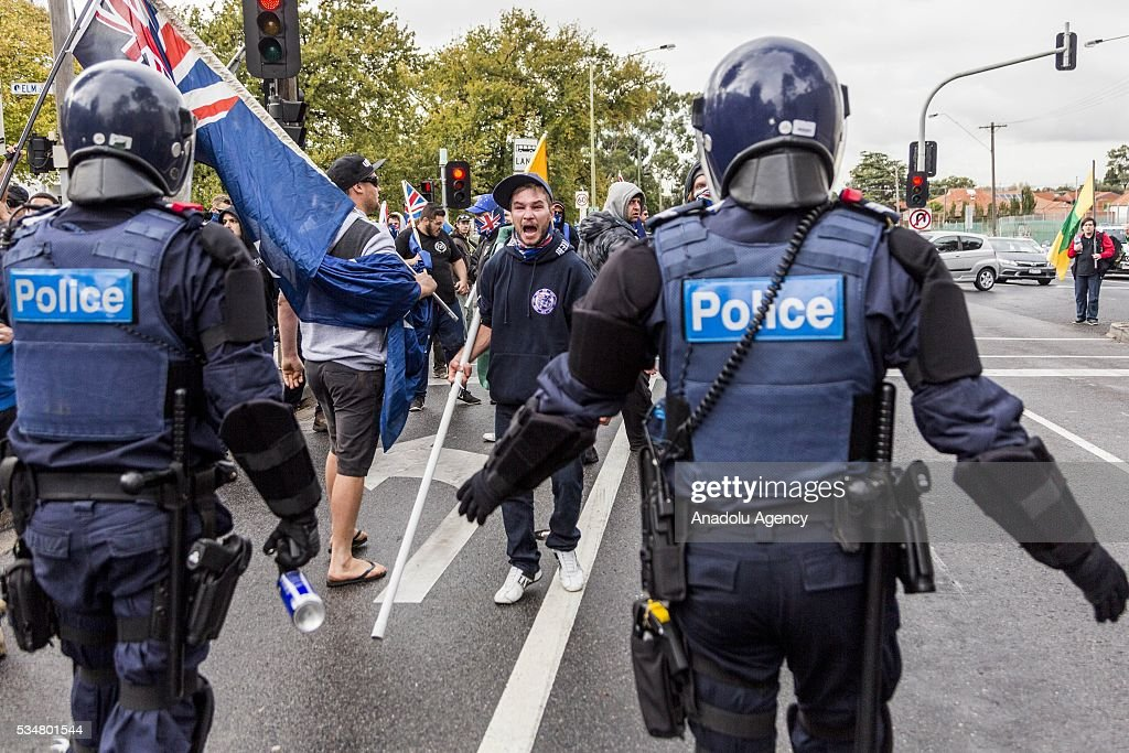 A True Blue Crew member shouts and antagonises Anti Fascists in front of riot police during a 'Say No To Racism' protest and a counter 'Stop the Far Left' rally in Coburg Melbourne, Australia on May 28, 2016. Seven men were arrested after a violent brawl erupted between rival protesters at an anti-racism rally in Melbourne's inner-north. Anti-Facists clashed with Anti-Islam nationalists who go by the name 'True Blue Crew'.