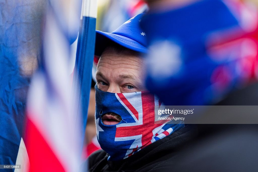 A True Blue Crew member wears an Australian Flag on his face during a protest organized by the anti-Islam True Blue Crew supported by the United Patriots Front in Melbourne, Australia on June 26, 2016.