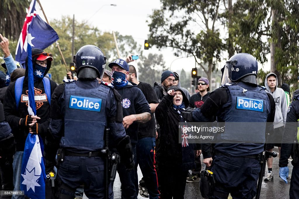 True Blue Crew members antagonise Anti Fascist protestors in front of riot police during a 'Say No To Racism' protest and a counter 'Stop the Far Left' rally in Coburg Melbourne, Australia on May 28, 2016. Seven men were arrested after a violent brawl erupted between rival protesters at an anti-racism rally in Melbourne's inner-north. Anti-Facists clashed with Anti-Islam nationalists who go by the name 'True Blue Crew'.