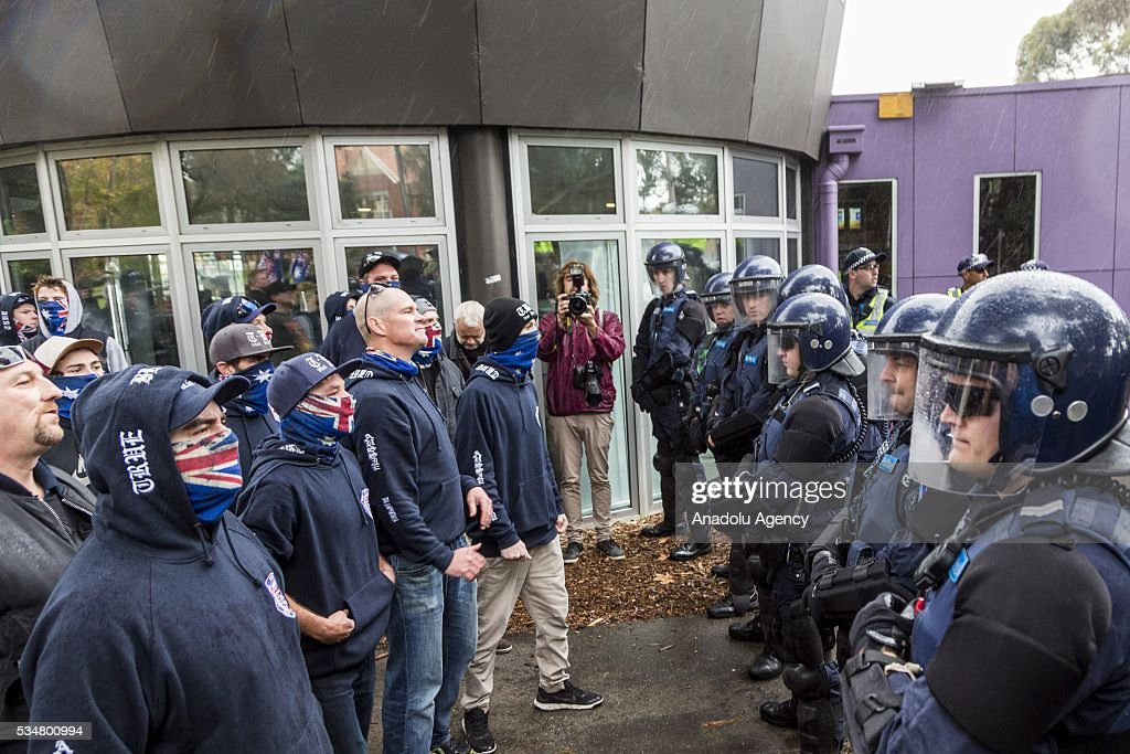 True Blue Crew members stand in a line in front of riot police during a 'Say No To Racism' protest and a counter 'Stop the Far Left' rally in Coburg Melbourne, Australia on May 28, 2016. Seven men were arrested after a violent brawl erupted between rival protesters at an anti-racism rally in Melbourne's inner-north. Anti-Facists clashed with Anti-Islam nationalists who go by the name 'True Blue Crew'.