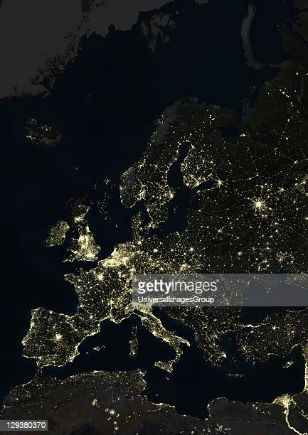 True colour satellite image of Europe at night This image in Lambert Conformal Conic projection was compiled from data acquired by LANDSAT 5 7...