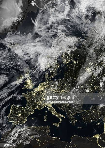 True colour satellite image of Europe at night with cloud coverage This image in Lambert Conformal Conic projection was compiled from data acquired...