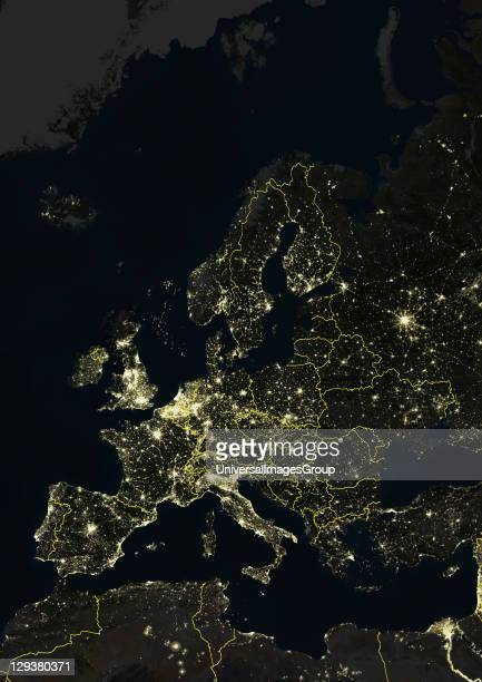 True colour satellite image of Europe at night with country borders This image in Lambert Conformal Conic projection was compiled from data acquired...