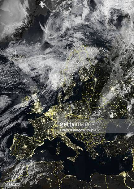 True colour satellite image of Europe at night with country borders and cloud coverage This image in Lambert Conformal Conic projection was compiled...