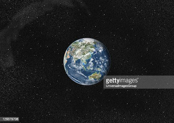 True colour satellite image of the Earth centred on Asia and Oceania with cloud coverage This image in orthographic projection was compiled from data...