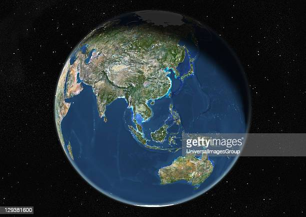 True colour satellite image of the Earth centred on Asia and Oceania during winter solstice at 6 am GMT This image in orthographic projection was...