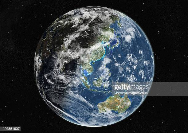 True colour satellite image of the Earth centred on Asia and Oceania with cloud coverage during winter solstice at 12 pm GMT This image in...