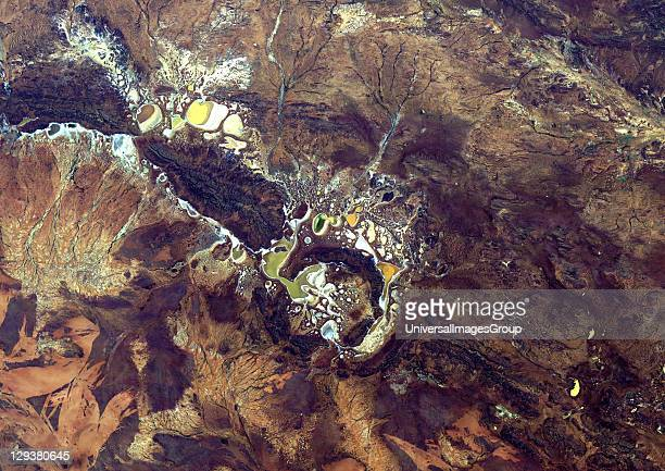 True colour satellite image of Western Australia's Shoemaker impact structure Resembling splotches of yellow and green paint saltencrusted seasonal...
