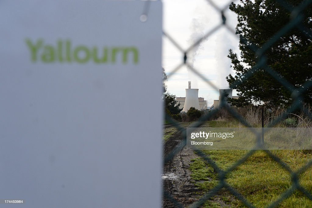TRUenergy Holdings Pty's Yallourn coal-fired power station stands behind a fence in Yallourn, Australia, on Thursday, July 25, 2013. Australian Prime Minister Kevin Rudd will cut spending and limit tax concessions to fund a move to emissions trading a year ahead of schedule, should his Labor government win this year's election. Photographer: Carla Gottgens/Bloomberg via Getty Images