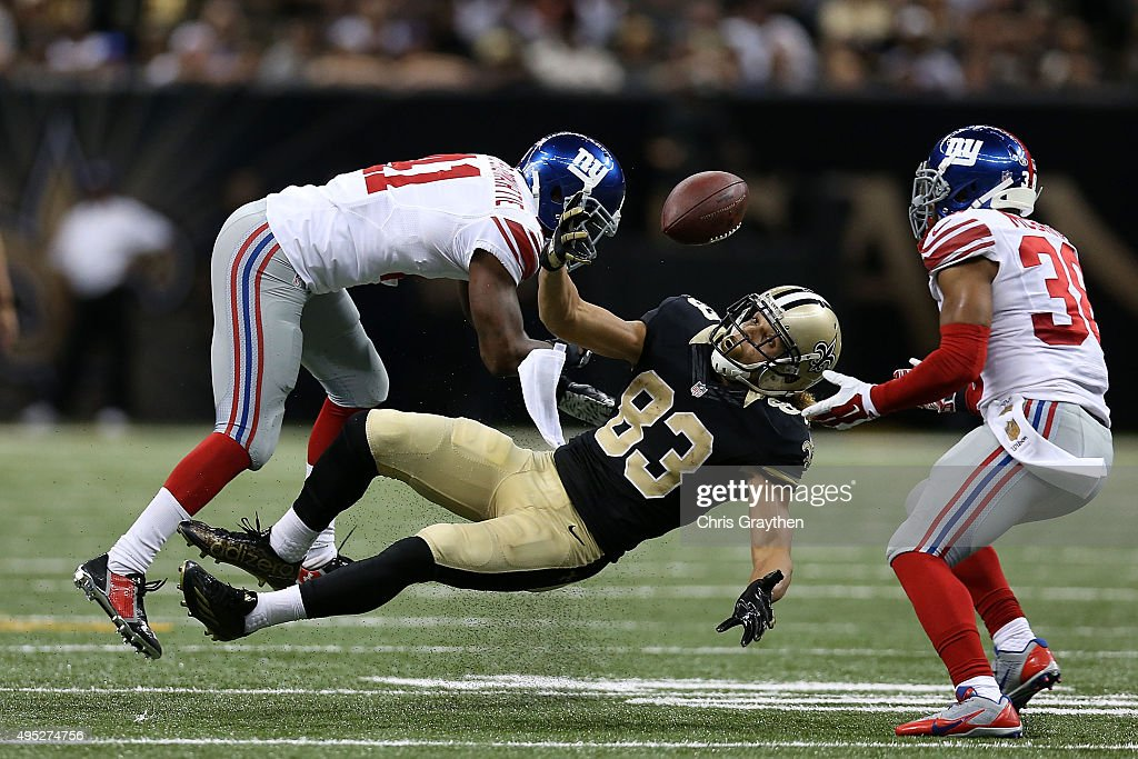 Trumaine McBride #38 of the New York Giants catches a loose ball lost by Willie Snead #83 of the New Orleans Saints during the fourth quarter of a game at the Mercedes-Benz Superdome on November 1, 2015 in New Orleans, Louisiana.
