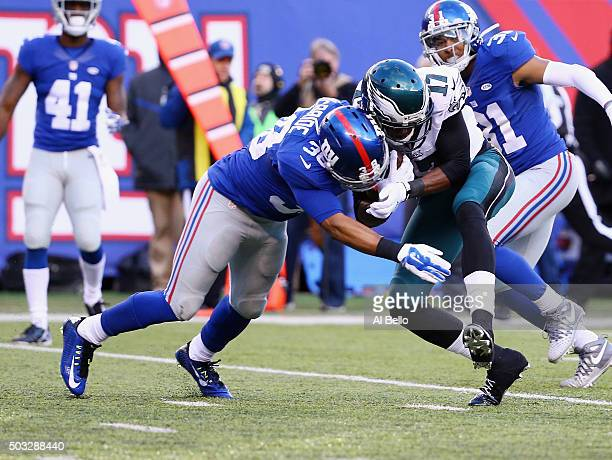 Trumaine McBride of the New York Giants is injured afterthis helmet to helmet hit against Nelson Agholor of the Philadelphia Eagles during their game...